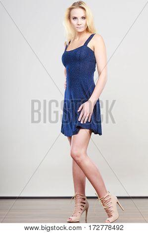 Blonde Woman Wearing Short Navy Cocktail Dress