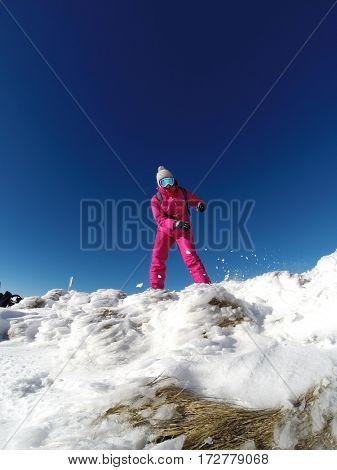 Female skier in ski suit enjoying in snowy mountain