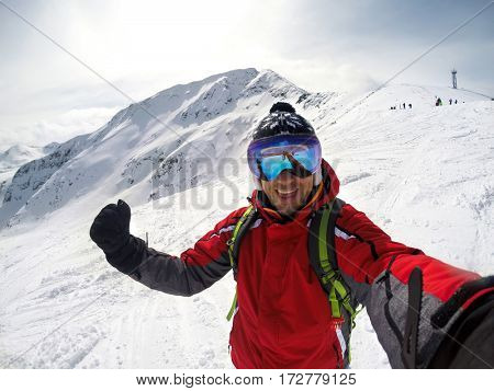 Happy skier in winter ambience on mountain