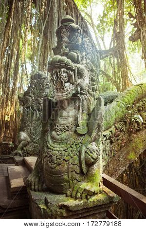 Statues and carvings depicting demons, gods and Balinese mythological deities on bridge in the Monkey Forest Sanctuary in Ubud, Bali.