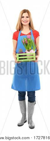Beautiful female florist holding box with house plants on white background