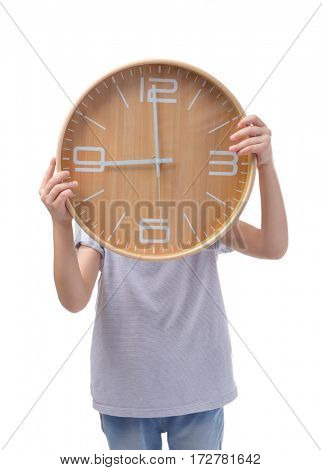 Cute little girl with big clock on white background