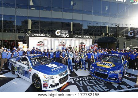 February 19, 2017 - Daytona Beach, Florida, USA: Dale Earnhardt Jr. (88) and Chase Elliott (24) take photos in victory lane after winning the pole award for the Daytona 500 in Daytona Beach, Florida.
