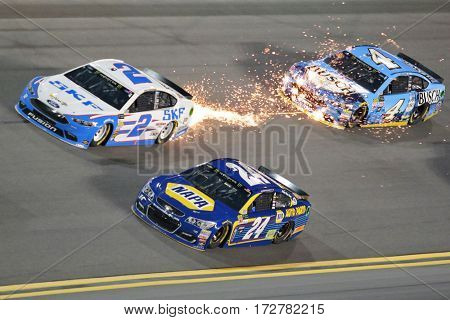 February 17, 2017 - Daytona Beach, Florida, USA:  Brad Keselowski (2)  sprays sparks onto Kevin Harvick (4)  during a practice session for the Advance Auto Parts Clash in Daytona Beach, Florida.
