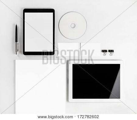 Photo of blank stationery set on white paper background. Responsive design template. Blank branding mock up. Blank objects for placing your design. Top view.