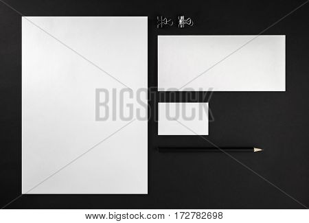 Blank stationery set. Corporate identity template on black background. Mock up for ID. Responsive design mockup. Blank objects for placing your design. Top view.