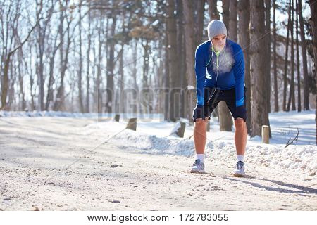 Sportsman on break from training in snowy nature