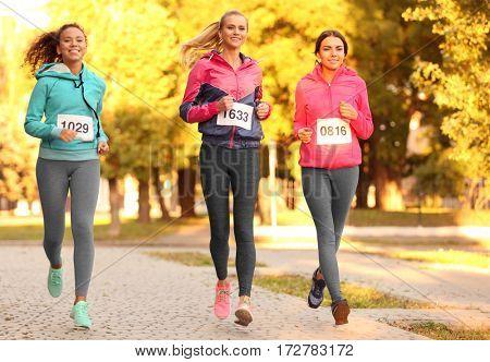 Sportsmen running on park pathway