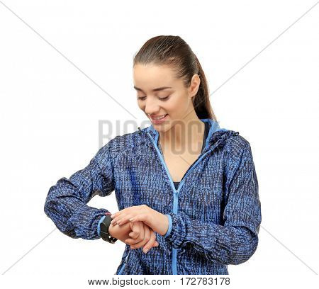 Young woman in sportswear with fitness tracker on white background