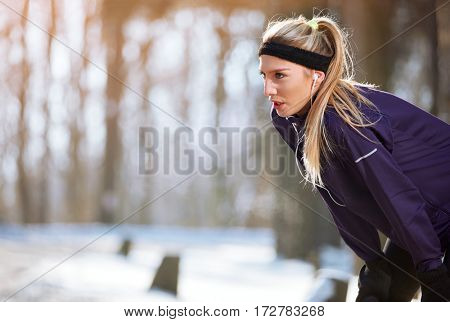Sportswoman stopped running to rest