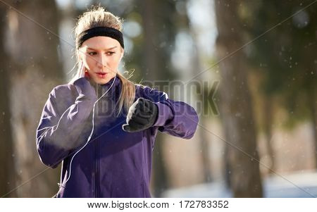 Woman measures pulse at cardio training