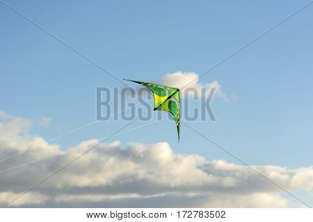 colorful kite floating in the sky blue sky Sunny day fly