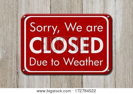 Closed due to weather sign A red sign with text Sorry we are closed due to weather on weathered wood 3D Illustration