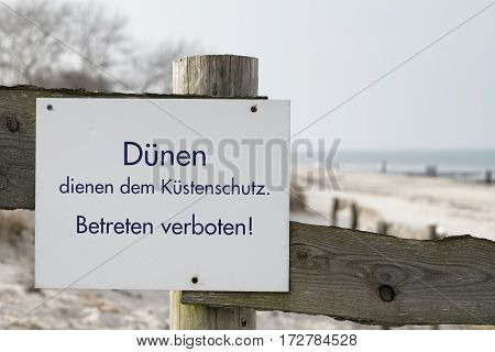 Sign on the beach of the Baltic Sea in Kuehlungsborn with the inscription