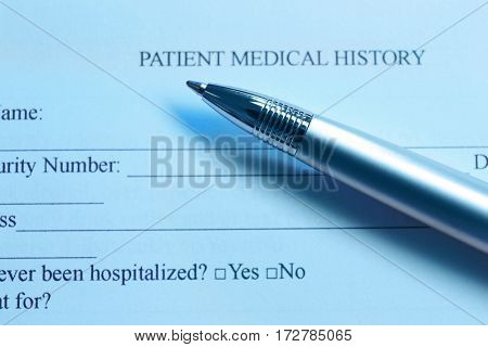 Pen on the patient medical history, closeup