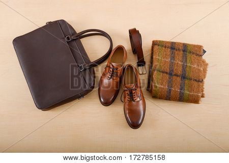 Set of scarf and various accessories for men on wooden background