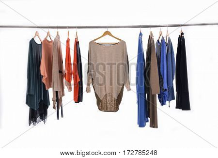 Variety of casual female clothes of different sundress on hangers