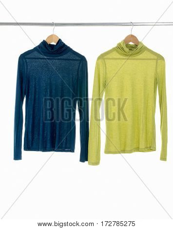 female yellow and blue clothing hanging on hangers