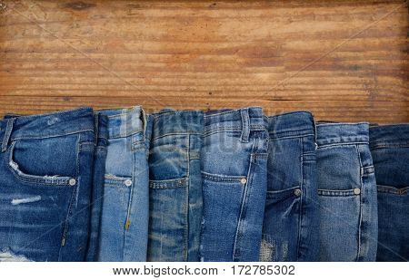 blue jeans on old rustic wooden.