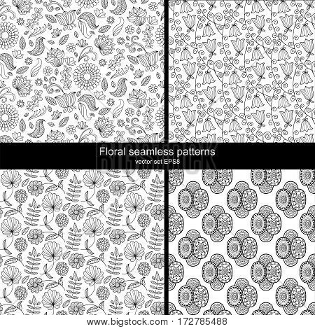 Stylish vector set of four black and white floral seamless patterns