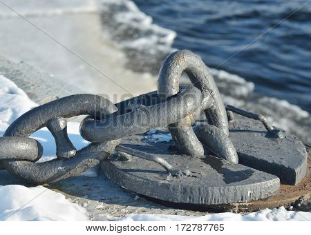 Sturdy metal chain at the dock.It is used for mooring ships.