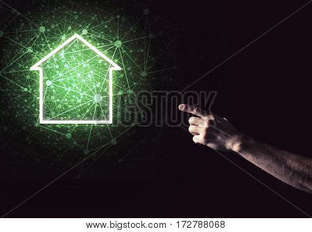 Hand of man touching with finger glowing home icon or symbol