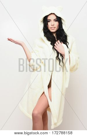 Sexy Girl Posing In Beige Velour Bathrobe