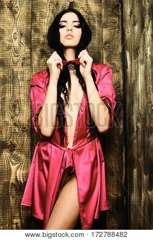 Sexy Girl In Pink Silk Robe Posing With Bandage