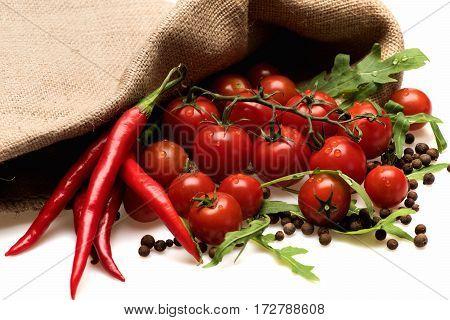 Fresh Vegetable, Cherry Tomato And Green Arugula Isolated On White