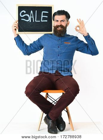 Bearded Man, Brutal Caucasian Hipster With Moustache Holding Sale Inscription