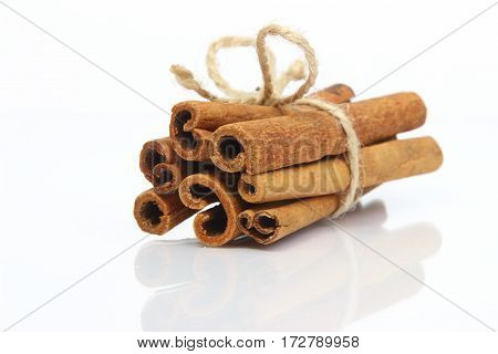 Cinnamon sticks spice bunch isolated on white background