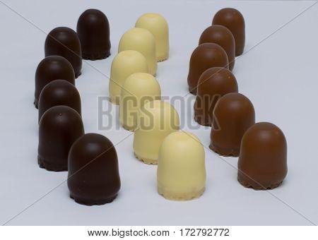 three arrays of dark, white and milk chocolate marshmallows