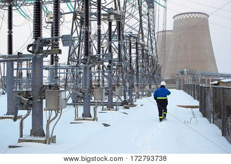 Electrician at power plant.Industrial equipment.Industrial equipment, electric substation work during the inspection.