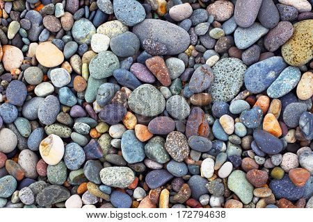 Background of stones. Pebble. Construction material.The texture and pattern of coastal pebbles closeup.