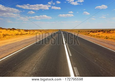 Open road.Abstract landscape with road in the desert countryside in the summer.