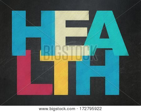 Health concept: Painted multicolor text Health on School board background, School Board