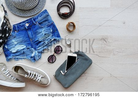 Trendy women closing on wooden background