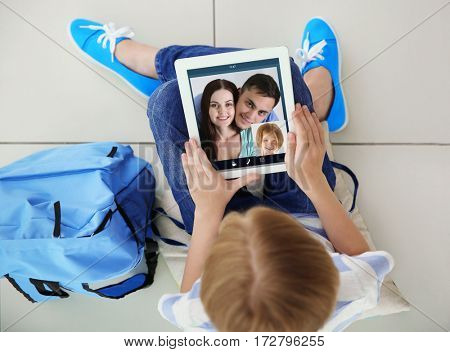Video call and chat concept. Girl video conferencing on tablet