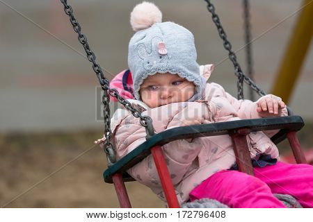 Little girl having fun on the swing