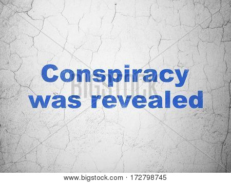 Politics concept: Blue Conspiracy Was Revealed on textured concrete wall background