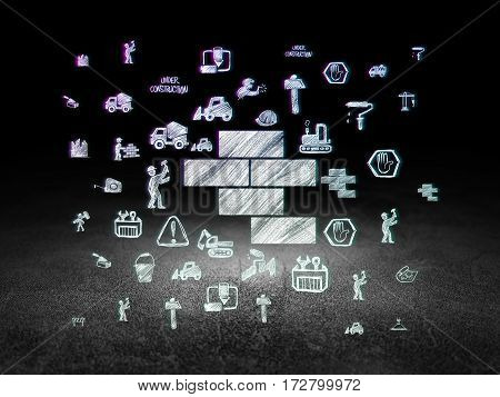 Construction concept: Glowing Bricks icon in grunge dark room with Dirty Floor, black background with  Hand Drawn Building Icons