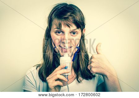 Woman Breathes With Face Mask Of Nebulizer