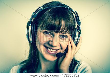 Call Centre Operator With Headset At Workplace In Call Center