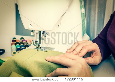 Fashion woman sews with sewing machine - sewing concept - retro style