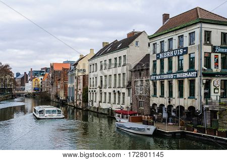 GHENT, BELGIUM - JANUARY 28, 2017: Houses on the riverside in Ghent Flanders Belgium