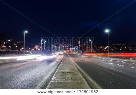 View of car streak lights at night in Autonomia bridge in Badajoz city