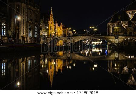 GHENT, BELGIUM - JANUARY 28, 2017: Reflection of medieval buildings at night in Ghent Flanders Belgium