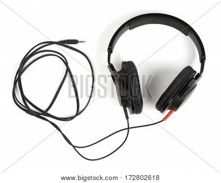 Closed back black stereo headphones isolated on white background