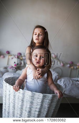 image of kids brother and sister in basket on meadow