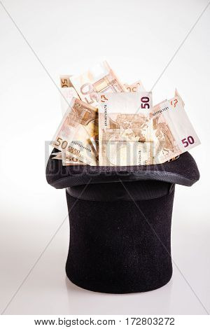 Top Hat Filled With Banknotes